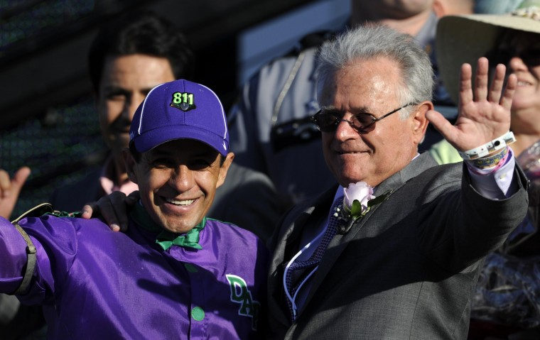 Victor Espinoza (left) and trainer Art Sherman in the winner's circle after California Chrome wins the 2014 Kentucky Derby at Churchill Downs in Louisville, Ky. (Jamie Rhodes/USA Today Sports)