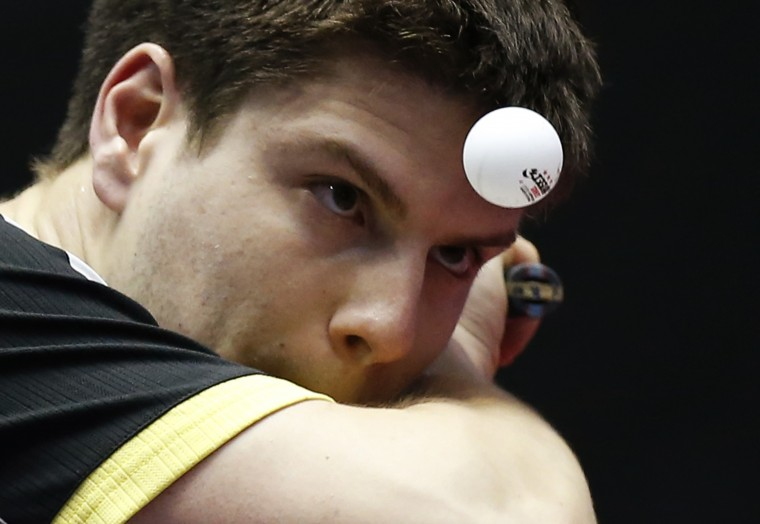 Germany's Dimitrij Ovtcharov eyes the ball as he serves to Singapore's Chew Zhe Yu Clarence during their men's quarter-final match at the World Team Table Tennis Championships in Tokyo. (Toru Hanai/Reuters)