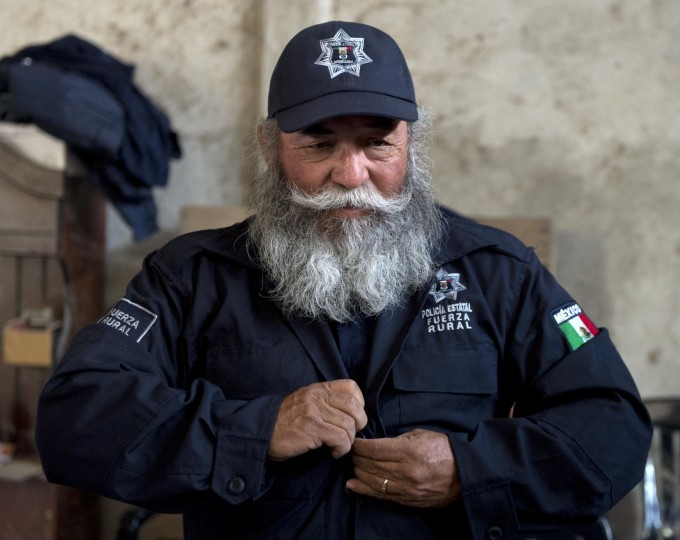 "Estanislao Beltran, aka ""Papa Pitufo"" (Papa Smurf in English), leader of the local self-protection police, wears the uniform of the newly created rural police, in Tepalcatepec, Michoacan State, Mexico. (Ronaldo Schemidt/AFP-Getty Images)"