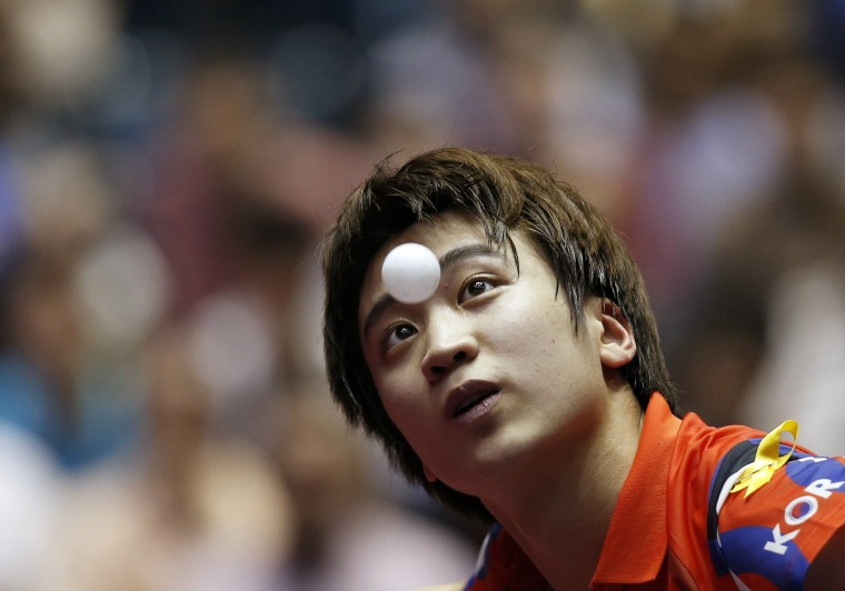 South Korea's Jung Young-sik eyes the ball as he serves to Taiwan's Chuang Chih-yuan during their men's quarter-final match at the World Team Table Tennis Championships in Tokyo. (Toru Hanai/Reuters)