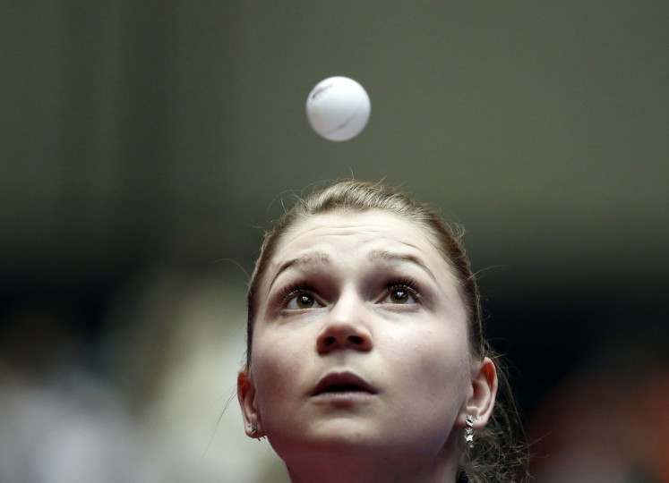 Romania's Daniela Monteiro Dodean eyes the ball as she serves to Singapore's Feng Tianwei during their women's quarter-final match at the World Team Table Tennis Championships in Tokyo. (Toru Hanai/Reuters)