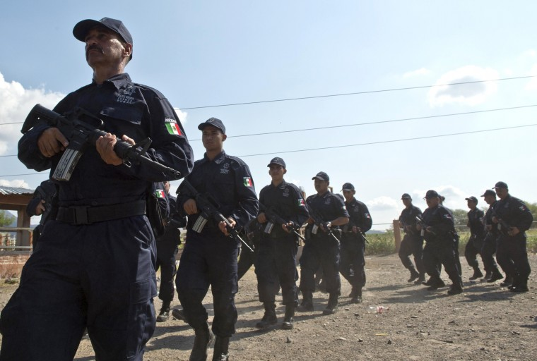 Members of the local Self-Protection Police wearing the uniforms of the new rural police, parade in Tepalcatepec, Michoacan State, Mexico,. . (Ronaldo Schemidt/AFP-Getty Images)