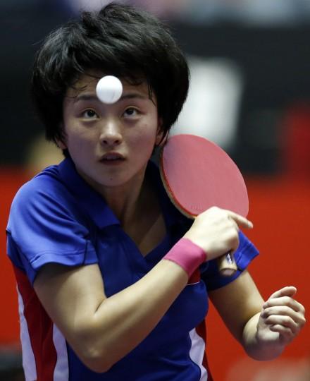 North Korea's Ri Myong Sun eyes the ball as she serves to China's Liu Shiwen during their women's quarter-final match at the World Team Table Tennis Championships in Tokyo. (Toru Hanai/Reuters)