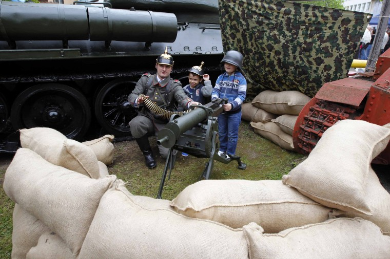 A man wearing a World War One uniform poses with children during an event marking 100 years since the Great War at Romania's National Military Museum in Bucharest. Members of various historic organizations presented original uniforms and re-enacted a battle from the First World War on the museum's open day. (Bogdan Cristel/Reuters)