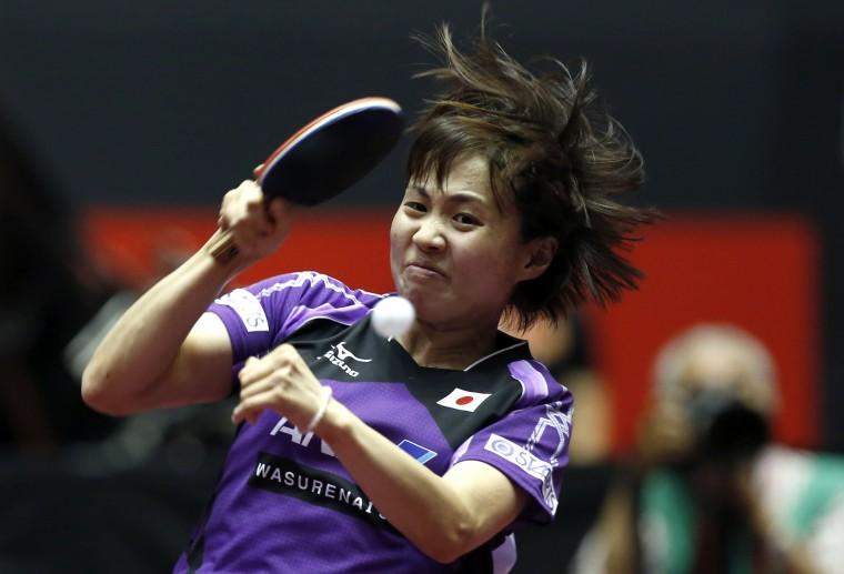 Japan's Sayaka Hirano hits a return to Netherlands' Britt Eerland during their women's quarter-final match at the World Team Table Tennis Championships in Tokyo. (Toru Hanai/Reuters)
