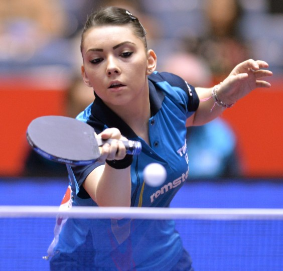 Romania's Bernadette Szocs returns a shot against Singapore's Li Isabelle Siyun during their women's team quarter-final match at the 2014 World Team Table Tennis Championships in Tokyo. Singapore beat Romania 3-1. (Kazuhiro Nogi/AFP-Getty Images)