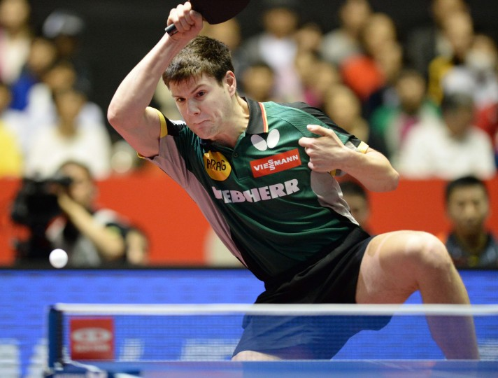 Dimitrij Ovtcharov of Germany returns a shot against Chew Zhe Yu Clarence of Singapore during their men's team quarter-final match of the 2014 World Team Table Tennis Championships in Tokyo. (Toru YAMANAKA/AFP-Getty Images)