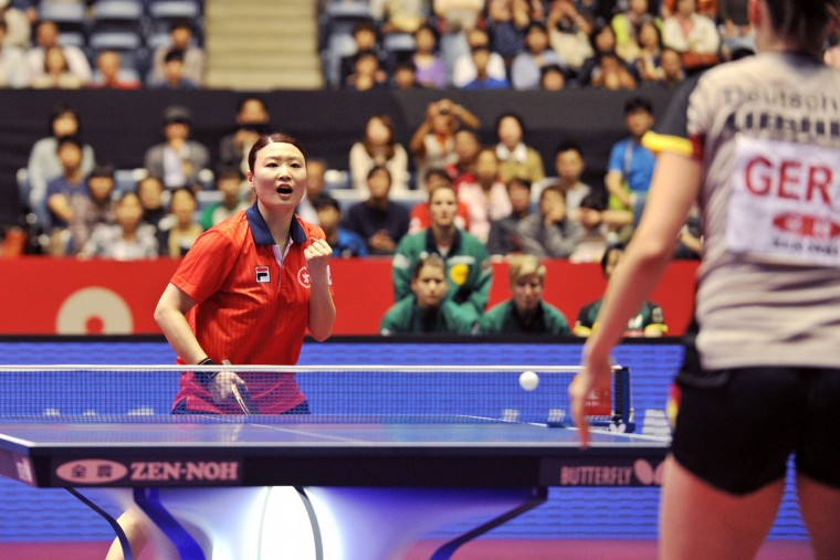 Hong Kong's Jiang Huajun reacts after her winning point against Germany's Irene Ivancan during their women's team quarter-final match at the 2014 World Team Table Tennis Championships in Tokyo on May 3, 2014. Hong Kong beat Germany 3-0. (Kazuhiro Nogi/AFP-Getty Images)