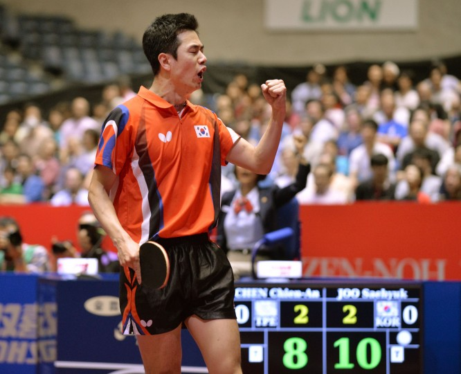 South Korea's Joo Saehyuk reacts after his winning point against Taiwan's Chen Chien-An returns during their men's team quarter-final match at the 2014 World Team Table Tennis Championships in Tokyo. (Kazuhiro Nogi/AFP-Getty Images)