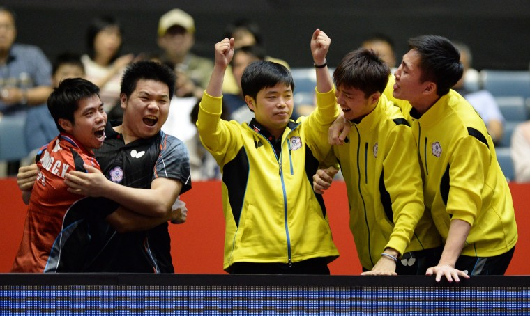 Taiwan team members celebrate their victory over South Korea during their men's team quarter-final match of the 2014 World Team Table Tennis Championships in Tokyo on May 1, 2014. Taiwan advanced to the semi-finals. (Toru Yamanaka/AFP-Getty Images)