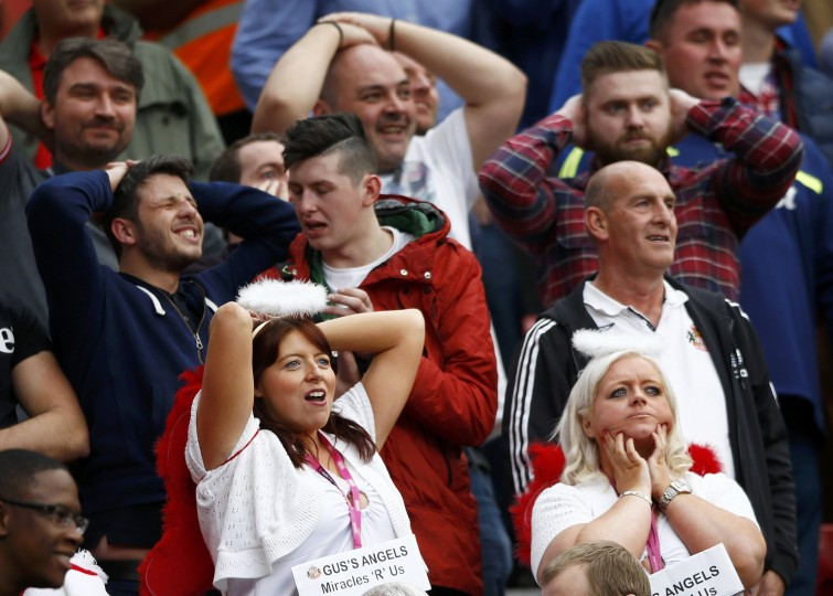 Sunderland fans react during their English Premier League soccer match against Manchester United at Old Trafford in Manchester. (Darren Staples/Reuters)
