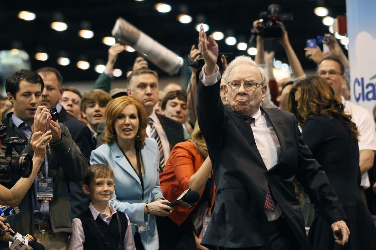 Berkshire Hathaway CEO Warren Buffett throws a newspaper during a competition at a trade show, at the company's annual meeting in Omaha, Neb. Buffett's Berkshire Hathaway Inc on Friday said quarterly profit declined 4 percent, falling short of analyst forecasts, as earnings from insurance underwriting declined and bad weather disrupted shipping at its BNSF Railway unit. (Rick Wilking/Reuters)