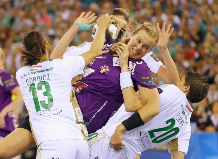 Susan Thorsgaard of Denmark's FC Midtjylland fights for the ball with Anita Gorbicz (13) and Raphaelle Tervel (20) of Hungary's Gyori Audi ETO KC during their Women's Handball Champion's League Final Four semi match in Budapest. (Laszlo Balogh/Reuters)
