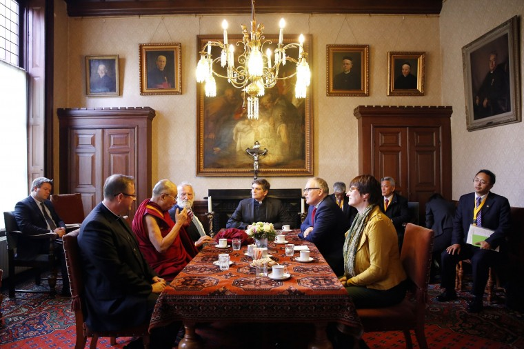 The Dalai Lama with (L-R) Bishop Woorts, Rabbi Soetendorp, Pastor van der Helm and Foreign Minister Frans Timmermans attends a meeting in the Jacobus Church in The Hague, The Netherlands. The spiritual leader is on a three-day visit in The Netherlands. (Bas Czerwinski/AFP-Getty Images)