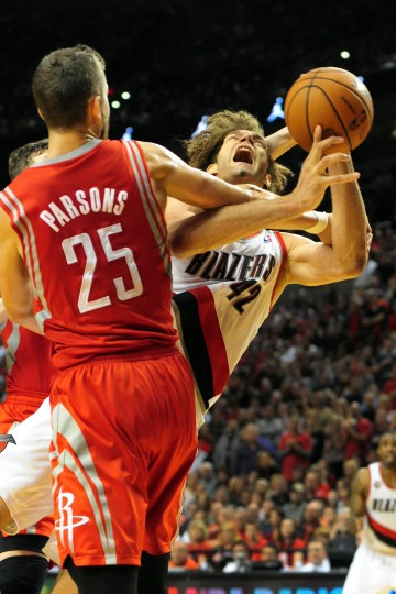 The Portland Trailblazer's Robin Lopez (42) is fouled by Houston Rocket Chandler Parsons (25) during the fourth quarter of Game Six of the Western Conference Quarterfinals during the 2014 NBA Playoffs at the Moda Center in Portland, Oregon. (Steve Dykes/Getty Images)