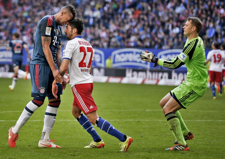Bayern Munich's Jerome Boateng (left)and Hamburg SV's Kerem Demirbay argue during their German Bundesliga first division soccer match in Hamburg. (Morris Mac Matzen/Reuters)