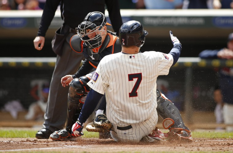 Minnesota Twins first baseman Joe Mauer (7) beats the tag of Baltimore Orioles catcher Steve Clevenger (45) to score from first in the first inning of their game at Target Field in Minneapolis. (Bruce Kluckhohn/USA Today Sports)