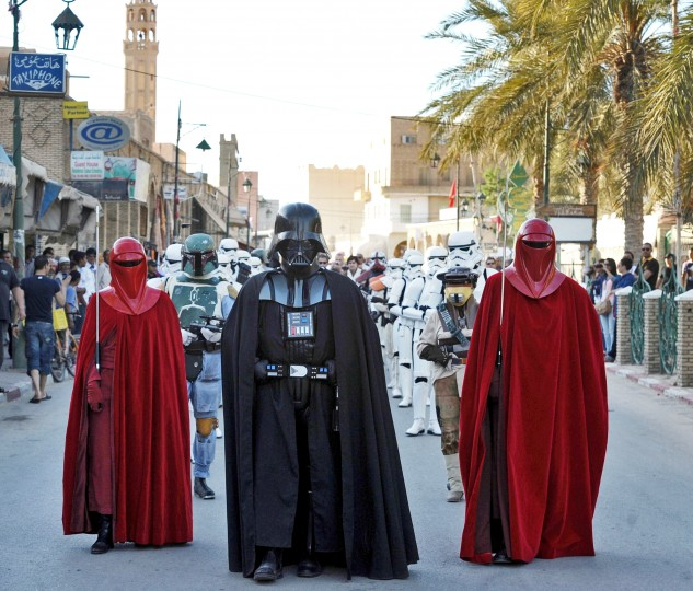 Fans of the Star Wars movie franchise parade while wearing costumes of the movie's characters, one being dressed as Darth Vader. It was the final day of the first international meeting of the fans of the movie in Tozeur, in southern Tunisia. (Fethi Belaid/AFP-Getty Images)