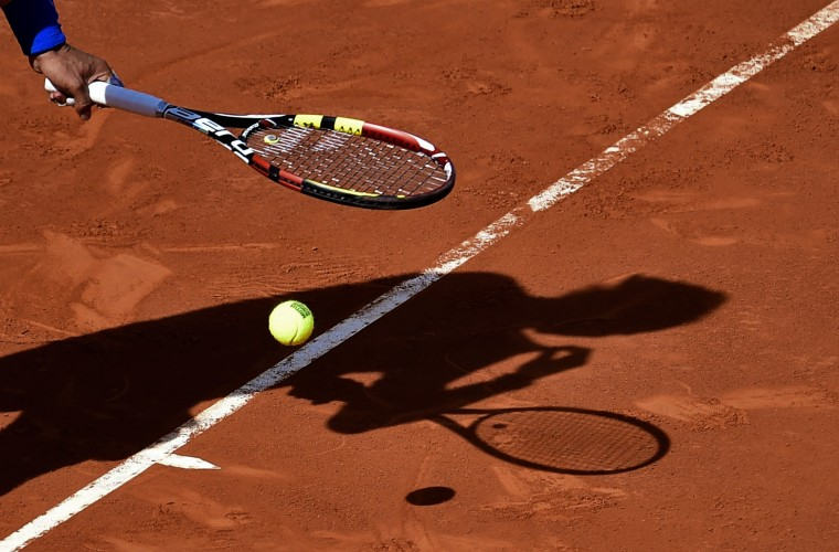 Spanish player Rafael Nadal prepares to serve against Spanish player Roberto Bautista Agut during their men's singles semi-final tennis match of the Madrid Masters at the Magic Box sports complex in Madrid. Nadal won the match 6-4, 6-3. (Pierre-Philippe Marcou/AFP-Getty Images)