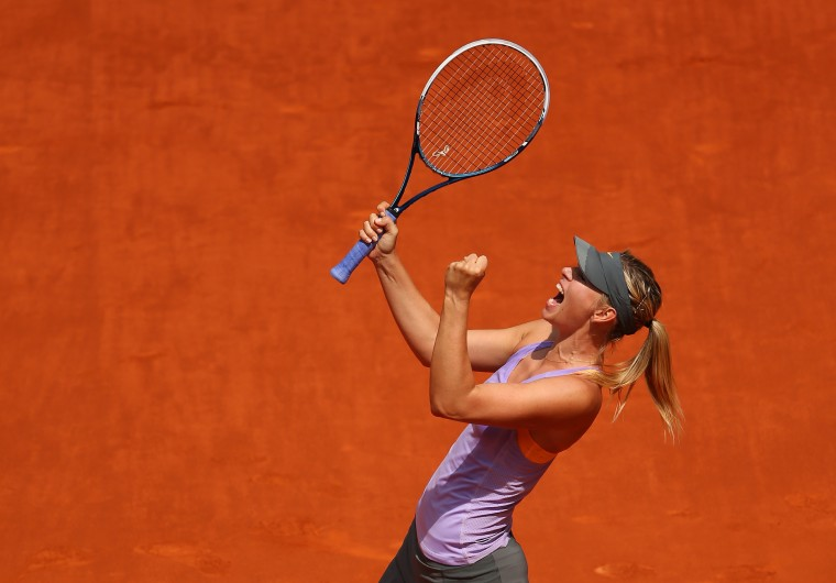 Maria Sharapova of Russia celebrates match point against Agnieszka Radwanska of Poland in their semi final match during day eight of the Mutua Madrid Open tennis tournament in Madrid, Spain. (Clive Brunskill/Getty Images)