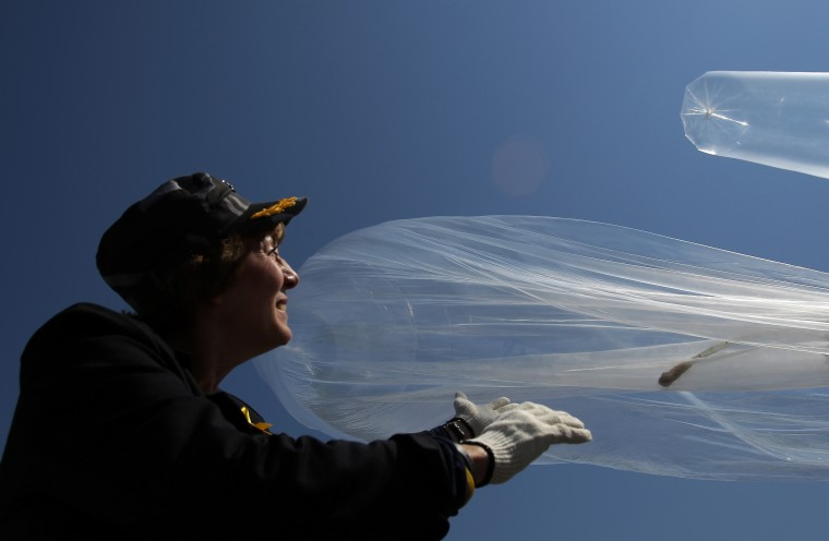 Suzanne Scholte, a human rights activist, stands near the Demilitarized Zone (DMZ) in Paju,South Korea, as she and others release balloons carrying propaganda leaflets denouncing North Korea's nuclear testing. The leaflets also denounce the North Korean government for human rights violations. (Chung Sung-Jun/Getty Images)