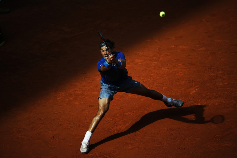 Rafael Nadal of Spain returns the ball to compatriot Roberto Bautista Agut during their men's singles semi-final match at the Madrid Open tennis tournament. (Susana Vera/Reuters)