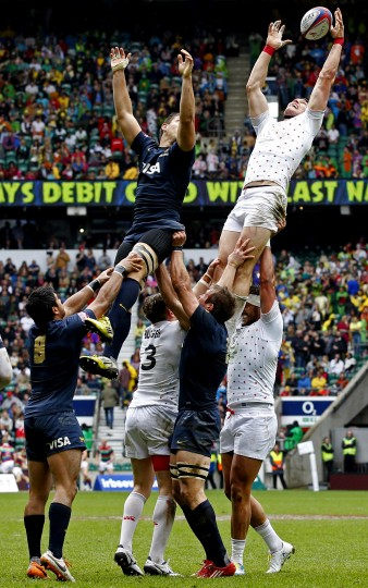 England's Tom Powell catches the ball in the line out against Argentina during the Rugby Union England Sevens Cup at Twickenham Stadium, southwest London. (Ian Kington/AFP-Getty Images)