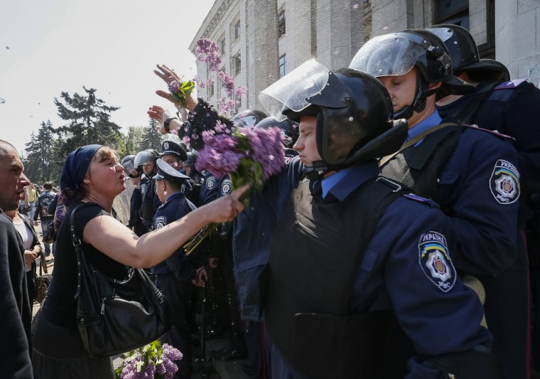 A woman argues with members from the Ukrainian Interior Ministry security forces during a rally outside a trade union building in Odessa. At least 42 people were killed in street battles between supporters and opponents of Russia in southern Ukraine that ended with pro-Russian protesters trapped in a flaming building, bringing the country closer to war. The riot in the Black Sea port of Odessa that ended in a deadly blaze in a trade union building was by far the worst incident in Ukraine since a February uprising that ended with a pro-Russian president fleeing the country. (Gleb Garanich/Reuters)