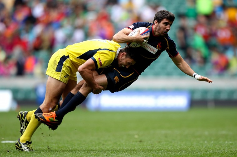 Matias Tudela of Spain is tackled by Peter Schuster of Australia during the Marriot London Sevens match between Australia and Spain at Twickenham Stadium in London, England. (Ben Hoskins/Getty Images)