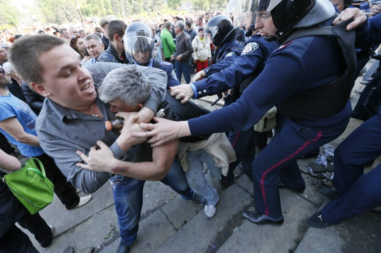 Men clash as members of Ukrainian Interior Ministry security forces approach to separate them during a rally outside a trade union building, where a deadly fire occured, in Odessa. At least 42 people were killed in street battles between supporters and opponents of Russia in southern Ukraine that ended with pro-Russian protesters trapped in a flaming building, bringing the country closer to war. The riot in the Black Sea port of Odessa that ended in a deadly blaze in the trade union building was by far the worst incident in Ukraine since a February uprising that ended with a pro-Russian president fleeing the country. (Gleb Garanich/Reuters)