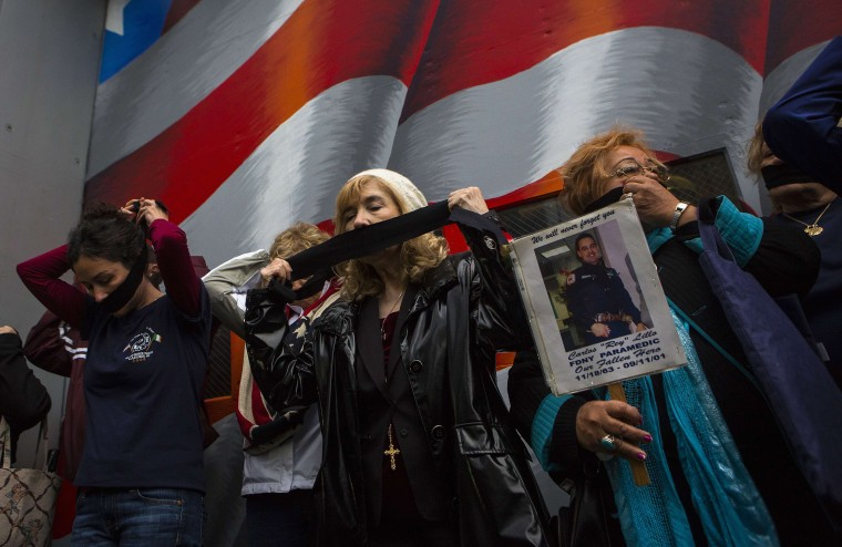Family members of victims of the September 11 attacks demonstrate against the decision to transfer the 9/11 unidentified remains to the Office of the Chief Medical Examiner of the City of New York (OCME) repository at the World Trade Center site, before the ceremonial transfer in New York May 10, 2014. Relatives, who are protesting, are incensed with the city over its plan to house the remains underground in the same building as the National September 11 Memorial Museum, local media reported. (Eric Thayer/Reuters)