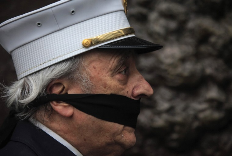 One of the family members of victims of the September 11 attacks with a cloth tied around his mouth demonstrates against the decision to transfer the 9/11 unidentified remains to the Office of the Chief Medical Examiner of the City of New York (OCME) repository at the World Trade Center site, before the ceremonial transfer in New York. Relatives, who are protesting, are incensed with the city over its plan to house the remains underground in the same building as the National September 11 Memorial Museum, local media reported. (Eric Thayer/reuters)