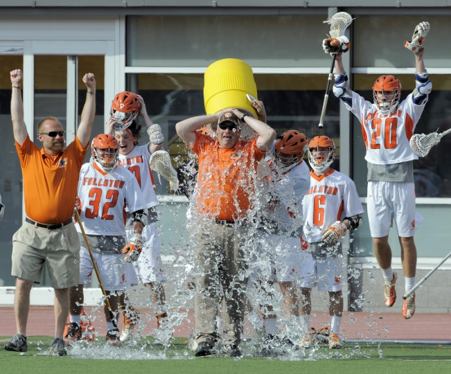 Fallston coach Matt Parks is covered in a cooler of water after his team dwon the 1A-2A state championship. (Lloyd Fox/Baltimore Sun)