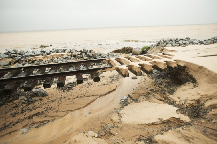 Train rails are washed out along Scenic Hwy 90 after heavy rains and flooding damage in Pensacola, Fla., on April 30, 2014. (REUTERS/Michael Spooneybarger)