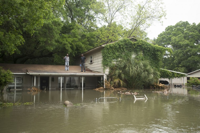 Residents wait for help after flooding in the Kelly Ave. Basin area of Pensacola, Fla., on April 30, 2014. (REUTERS/Michael Spooneybarger)