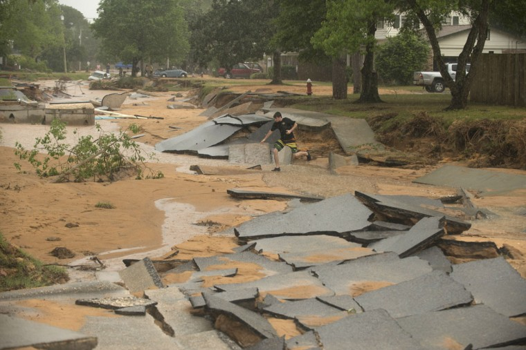 Jaymond Allison surveys flood damage to the Cordova Park neighborhood in Pensacola, Fla., on April 30, 2014. (REUTERS/Michael Spooneybarger)