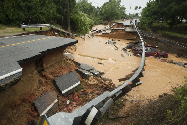 Damage due to flash flooding is seen along Johnson Ave. in Pensacola, Fla., on April 30, 2014. (REUTERS/Michael Spooneybarger)