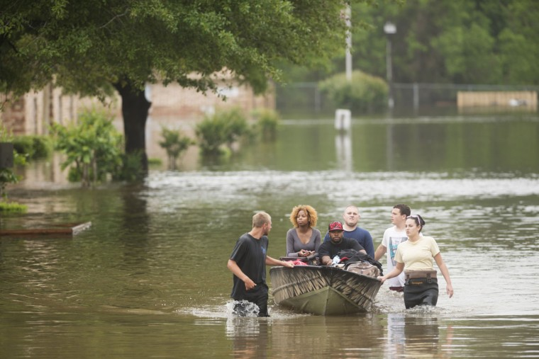 Residents of Forest Creek Apartments are rescued after heavy flooding in Pensacola, Fla., on April 30, 2014. (REUTERS/Michael Spooneybarger)