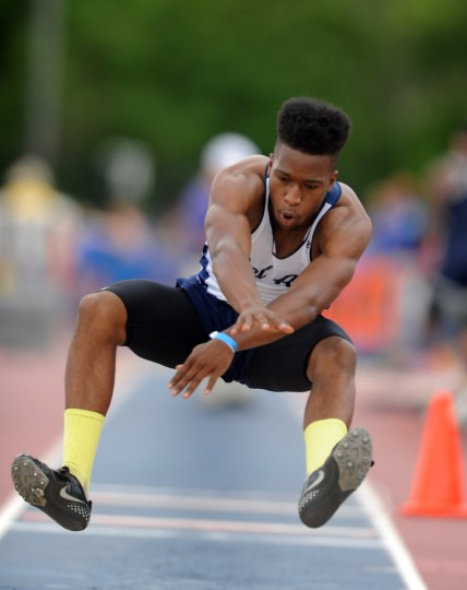 Bel Air's Christopher Davis competes in the 3A boys triple jump during the 2014 track and field state championships at Morgan State University. (Brian Krista/BSMG)