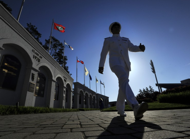 Midshipman Shawn Reed gets ready for graduation as he walks inside the Navy Marine Corps Memorial Stadium. Lloyd Fox/Baltimore Sun