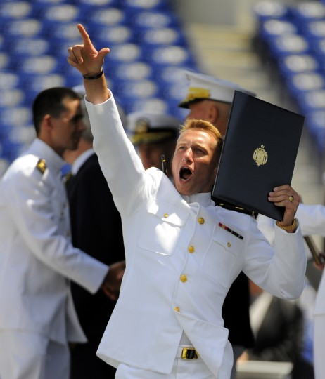 Midshipman Christopher Junghans of Dunkirk, MD celebrates after receiving his diploma. Lloyd Fox/Baltimore Sun
