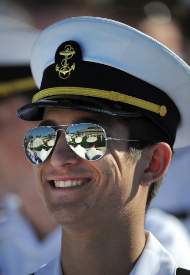 Midshipman 3rd class Jonathan Furseth watches his fellow midshipman during graduation. Lloyd Fox/Baltimore Sun