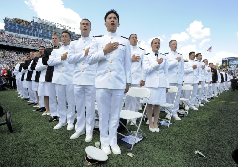 Midshipman Justin Chock, center, and fellow graduates during the graduation ceremonies. About 30,000 people attended the ceremony to celebrate the graduation of 1,068 midshipmen, who were commissioned as Navy ensigns and Marine Corps second lieutenants after four years in Annapolis. Lloyd Fox/Baltimore Sun