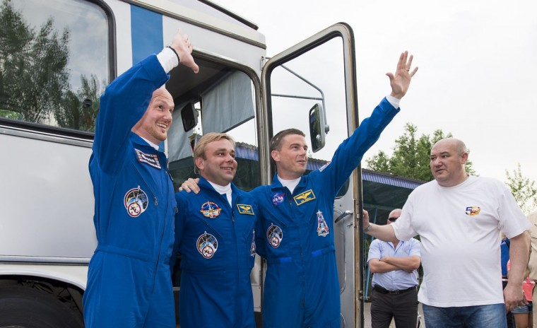 Expedition 40 Flight Engineer Alexander Gerst of the European Space Agency (ESA), Soyuz Commander Maxim Suraev of the Russian Federal Space Agency (Roscosmos) and Flight Engineer Reid Wiseman of NASA, wave before they depart the Cosmonaut Hotel May 28, 2014 in Baikonur, Kazakhstan. Suraev, Gerst and Wiseman will launch aboard a Soyuz spacecraft to the International Space Station on May 29. (Photo Joel Kowsky/NASA via Getty Images)