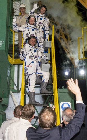 Expedition 40 Soyuz Commander Maxim Suraev of the Russian Federal Space Agency (Roscosmos), Flight Engineer Alexander Gerst of the European Space Agency (ESA), and Flight Engineer Reid Wiseman of NASA, wave prior to boarding the Soyuz TMA-13M rocket for launch May 28, 2014 in Baikonur, Kazakhstan. Suraev, Gerst and Wiseman will launch aboard a Soyuz spacecraft to the International Space Station on May 29. (Photo Joel Kowsky/NASA via Getty Images)