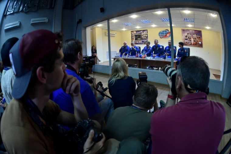 European Space Agency's German astronaut Alexander Gerst (back, L), Russian cosmonaut Maxim Suraev (back, 2ndL) and US NASA astronaut Gregory Wiseman (back, 3rdL) attend their press-conference at the Russian-leased Baikonur cosmodrome on May 27, 2014.The three-man crew of European Space Agency's German astronaut Alexander Gerst, Russian cosmonaut Maxim Suraev and US NASA astronaut Gregory Wiseman is scheduled to blast off to the ISS from Baikonur on May 28. (Kirill Kudryavtsev/AFP/Getty Images)
