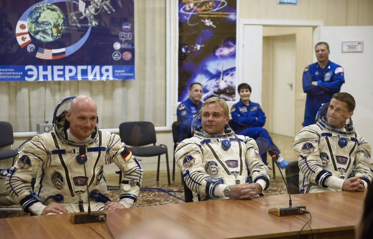 This handout picture taken a released by the European Space Agency (ESA) on May 28, 2014 shows Expedition 40/41 crew members - ESA German astronaut Alexander Gerst, Russian cosmonaut Max Suraev, and US astronaut Reid Wiseman of NASA sitting wearing dressed in their Russian Sokol space suits, in preparation for launch of a Soyuz rocket will connect with the International Space Station (ISS), in Baikonur Cosmodrome in Kazakhstan.
