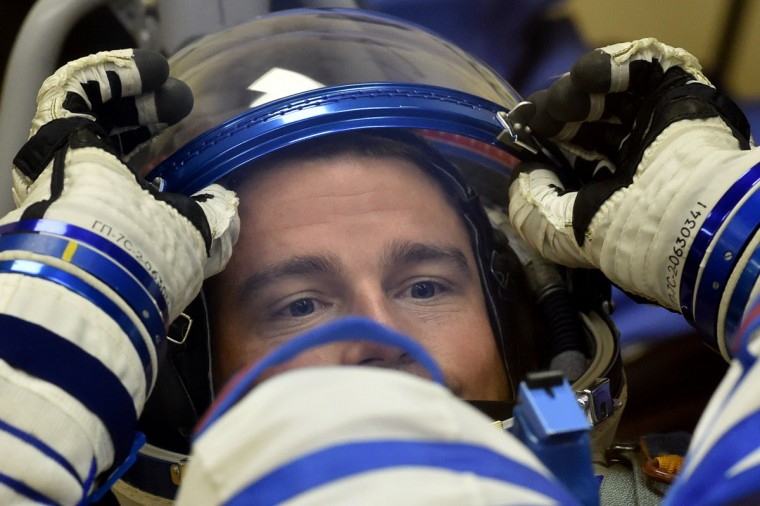 US NASA astronaut Gregory Wiseman tests his space suit at the Russian-leased Baikonur cosmodrome, prior to blasting off to the International Space Station (ISS) late on May 28, 2014. The launch of the Soyuz TMA-13M with the international crew aboard is scheduled early on May 29 local time. (Kirill Kurayavtsev/AFP/Getty Images)