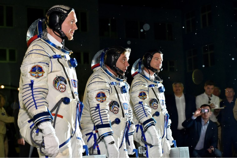 European Space Agency's German astronaut Alexander Gerst, Russian cosmonaut Maxim Suraev and US NASA astronaut Gregory Wiseman walk after their space suits were tested at the Russian-leased Baikonur cosmodrome late on May 28, 2014 . The launch of the Soyuz TMA-13M with the international crew aboard is scheduled early on May 29 local time. (Dmitry Lovetsky/AFP/Getty Images)