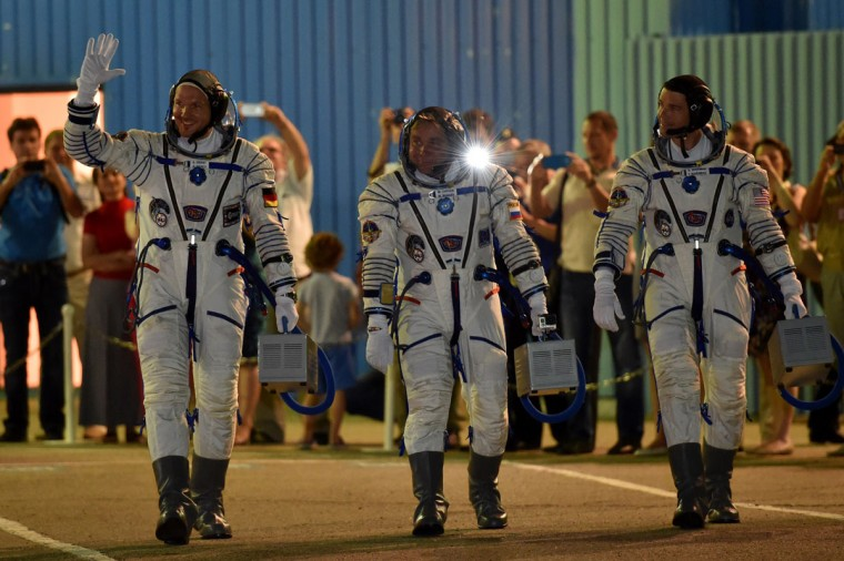 European Space Agency's German astronaut Alexander Gerst (L), Russian cosmonaut Maxim Suraev (C) and US NASA astronaut Gregory Wiseman walk after their space suits were tested at the Russian-leased Baikonur cosmodrome, prior to blasting off to the International Space Station (ISS) late on May 28, 2014 . The launch of the Soyuz TMA-13M with the international crew aboard is scheduled early on May 29 local time. (Kirill Kudryavtsev/AFP/Getty Images)
